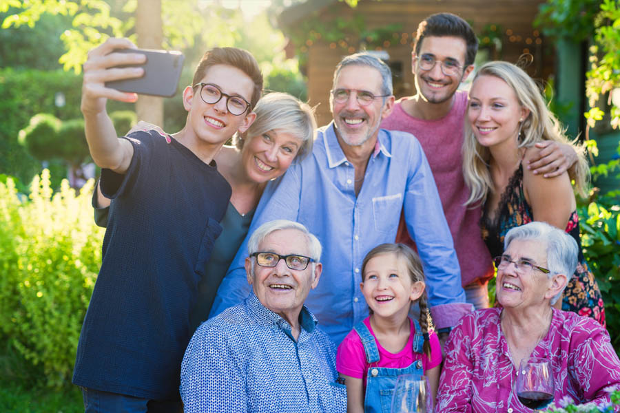 Blog - Family Taking a Selfie at a Picnic Outside