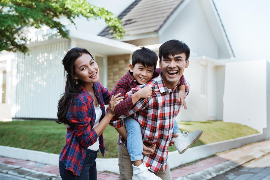 Personal Insurance - Family Standing in Front of Their Home in North Carolina